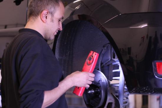Mechanic repairs car in Hampton Motors